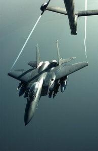 An F-15E disengaging from a KC-10 during Operation Iraqi Freedom. Note the visible wingtip vortices.