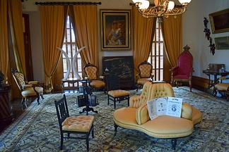 Interior of the music room with donations and artifacts in the restored palace