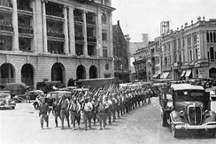 Victorious Japanese troops march through the city center of Singapore following the city's capture in February 1942 (Photo from the Imperial War Museum)