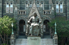 Statue of Carroll in front of Healy Hall on the campus of Georgetown University