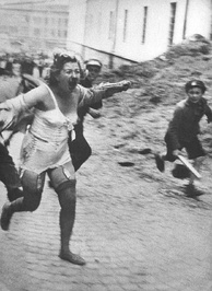 Jewish woman chased by men and youth armed with clubs during the Lviv pogroms, July 1941, then occupied Poland, now Ukraine