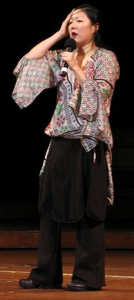 Cho doing stand-up in June 2005.