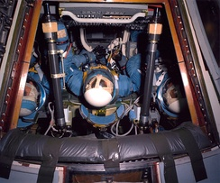 McDivitt, Scott and Schweickart were training for the second Apollo mission on January 26, 1967, in the first Block II command module, wearing early blue versions of the Block II pressure suit.