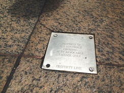 A metal plaque on the sidewalk of New York City declares that the crossing onto the private property is a revocable license (an agreement to use the property, not an invasion) to protect it from becoming a subject of an adverse possession.[35] Some New York property owners go even further by actually closing their property to the public for one day each year in order to prove their exclusive control.[36]
