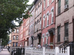Row houses are prominent in many Queens neighborhoods, including Ridgewood.