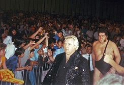 Roussimoff was managed by Bobby Heenan (foreground) during parts of his feud with Hulk Hogan.