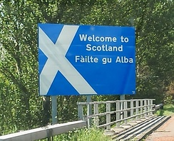 Sign on the northbound A74(M) on the Scottish border near its southern end