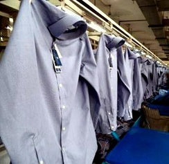 Dress shirts hanging on a production line