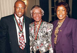 Shirley Chisholm (center) with Congressman Edolphus Towns (left) and his wife, Gwen Towns (right)