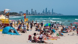 Summer at Burleigh Heads beach with the Gold Coast skyline in the distance. Gold Coast beaches are world-renowned.