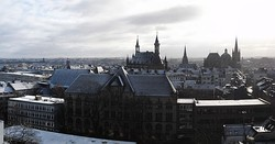 Panoramic view of Aachen, including Kaiser-Karls-Gymnasium (foreground), city hall (back centre) and cathedral (back right)