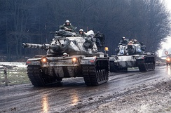 Two M-60A3 tanks in Germany during Exercise Reforger 85