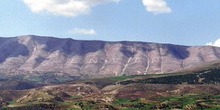 Mount Shpiragu as seen from Berat showing the name of Hoxha written on its side