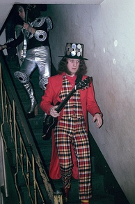 Noddy Holder (right) and Dave Hill (left), near the height of their fame in 1973, showing some of their more extreme glam rock fashions.