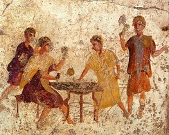 Ancient fresco of dice players in Pompei.