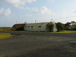 Another Quonset hut that remains in the district of Aeroporto, literally Airport