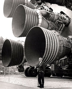 Wernher von Braun with the F-1 engines of the Saturn V first stage at the U.S. Space and Rocket Center