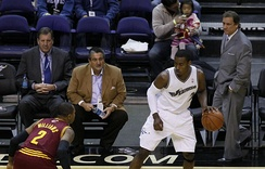 Owner Ted Leonsis and then coach Flip Saunders watch John Wall in 2010.