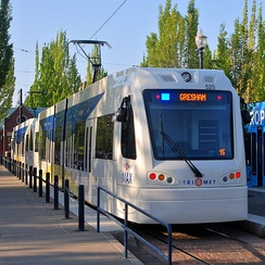 A MAX light rail train parked at the Hatfield Government Center Station in Downtown Hillsboro. The train is a pair of Type 5 LRVs.