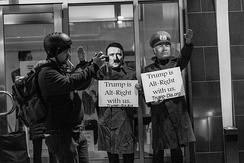 """Trump is Alt-Right with Us."" Anti-Trump protesters highlight what they regard as his links to the alt-right and to historical fascism by dressing as Hitler and Mussolini."