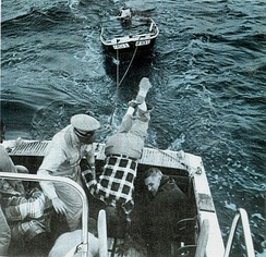 Auxiliarists in 1967 rescuing a boater off an outboard that had foundered during a storm in Long Island Sound, New York.