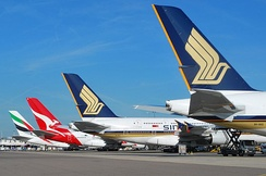 Singapore Airlines, Qantas, and Emirates Airbus A380s parked at London Heathrow