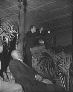 Powell addressing a citizens' committee mass meeting