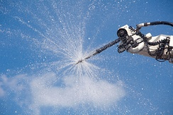 Spray nozzle in use on airport crash tender