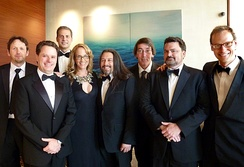 Wright and other game developers at a BAFTA event in Los Angeles in July 2011. From left: Rod Humble, Louis Castle, David Perry, Brenda Brathwaite, John Romero, Will Wright, Tim Schafer, Chris Hecker.