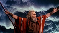 Rear projection, an in-camera effect, placed cloud effects behind Charlton Heston