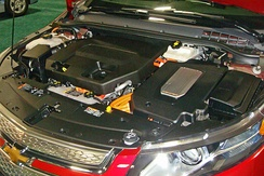 Right side: power inverter on top of the electric motor used for traction; left side: the 1.4 L gasoline engine used as a generator to keep the battery at minimum charge.