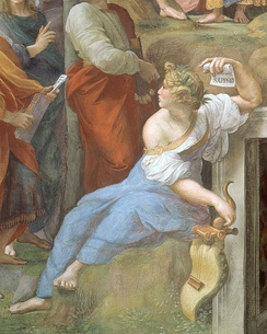 Detail of Sappho from Raphael's Parnassus (1510–11), shown alongside other poets. In her left hand, she holds a scroll with her name written on it.[160]