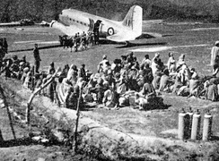 Refugees awaiting evacuation by IAF Dakota on Poonch airstrip, December 1947.