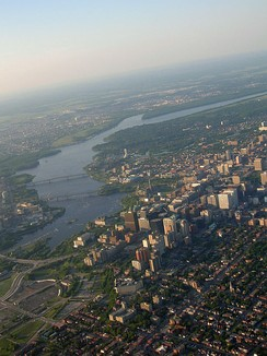 Downtown Ottawa is situated on the south bank of the Ottawa River. Gatineau may be seen in the background, across the river.
