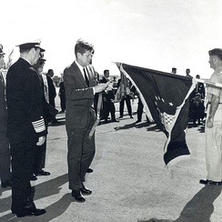 President Kennedy presents AFOUA to the 363 TRW in 1962 in recognition of the unit's actions associated with the Cuban Missile Crisis.