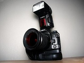 Dynax 7 w/ 28-100 mm lens, VC-7 vertical grip and 5600HS flash