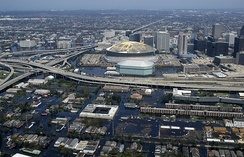 An aerial view from a United States Navy helicopter showing floodwaters around the Louisiana Superdome (stadium) and surrounding area (2005)