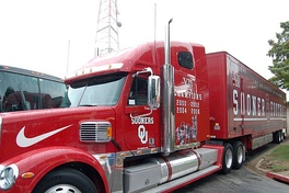 Oklahoma Sooners transport truck carries team equipment for road games.