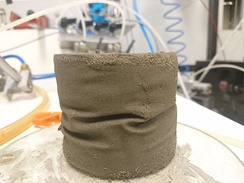Post-liquefaction testing. The fine sand specimen was liquefied during consolidates undrained (CU) cycles and recovered with consolidated drained (CD) cycles many times. The wrinkles formed due to the volume change imposed by iterating between CU liquefaction and draining. In a liquefied state the sample becomes soft enough to imprint thin latex. During CD cycles - stiff enough to preserve the imprinted pattern.