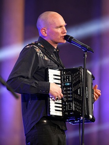 Rainer von Vielen-Heimatsound playing a Roland digital V-Accordion. The bank of electronic switches can change the accordion's sound, tone and volume.