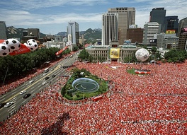 South Koreans watching their nation on the big screens in Seoul Plaza during the 2002 World Cup when they became the first Asian country to reach the semi-finals.