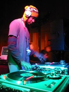 DJ Spooky at the Sundance Film Festival in 2003, using two Technics SL-1200 turntables and a DJ mixer
