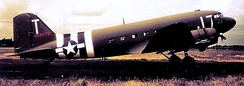 Douglas C-47A-15-DK Skytrain Serial 42-92879 of the 303rd TCS/442d TCG at Fullbeck in Normandy invasion markings.