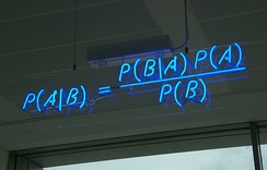 A blue neon sign showing the simple statement of Bayes's theorem