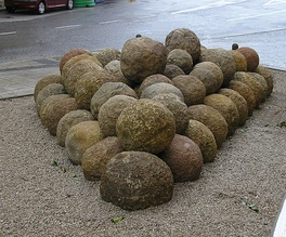 bolaños, stone balls used during the 1342 siege, now in the archaeological park of the sea walls