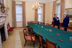 David Cameron showing John Kerry around the Cabinet Room in 2016