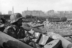 October 1942: A German soldier with a Soviet PPSh-41 submachine gun in Barrikady factory rubble