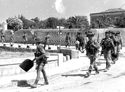 Men of The Loyal Edmonton Regiment, part of the 1st Canadian Division, enter Modica.