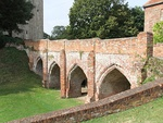 Hedingham Castle, bridge spanning dry moat between inner and outer baileys and including attached retaining wall to north west