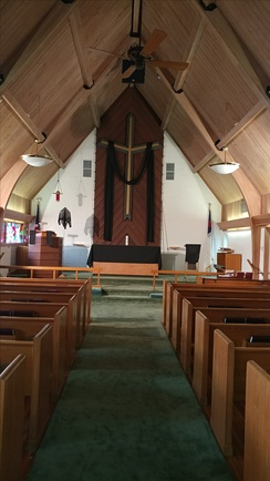 The chancel of this Lutheran church features a very large altar cross.